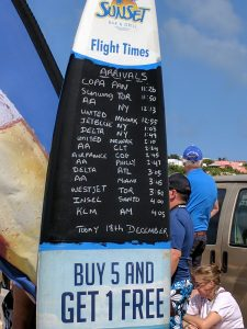 Arrival times for major airlines are posted on the beach.